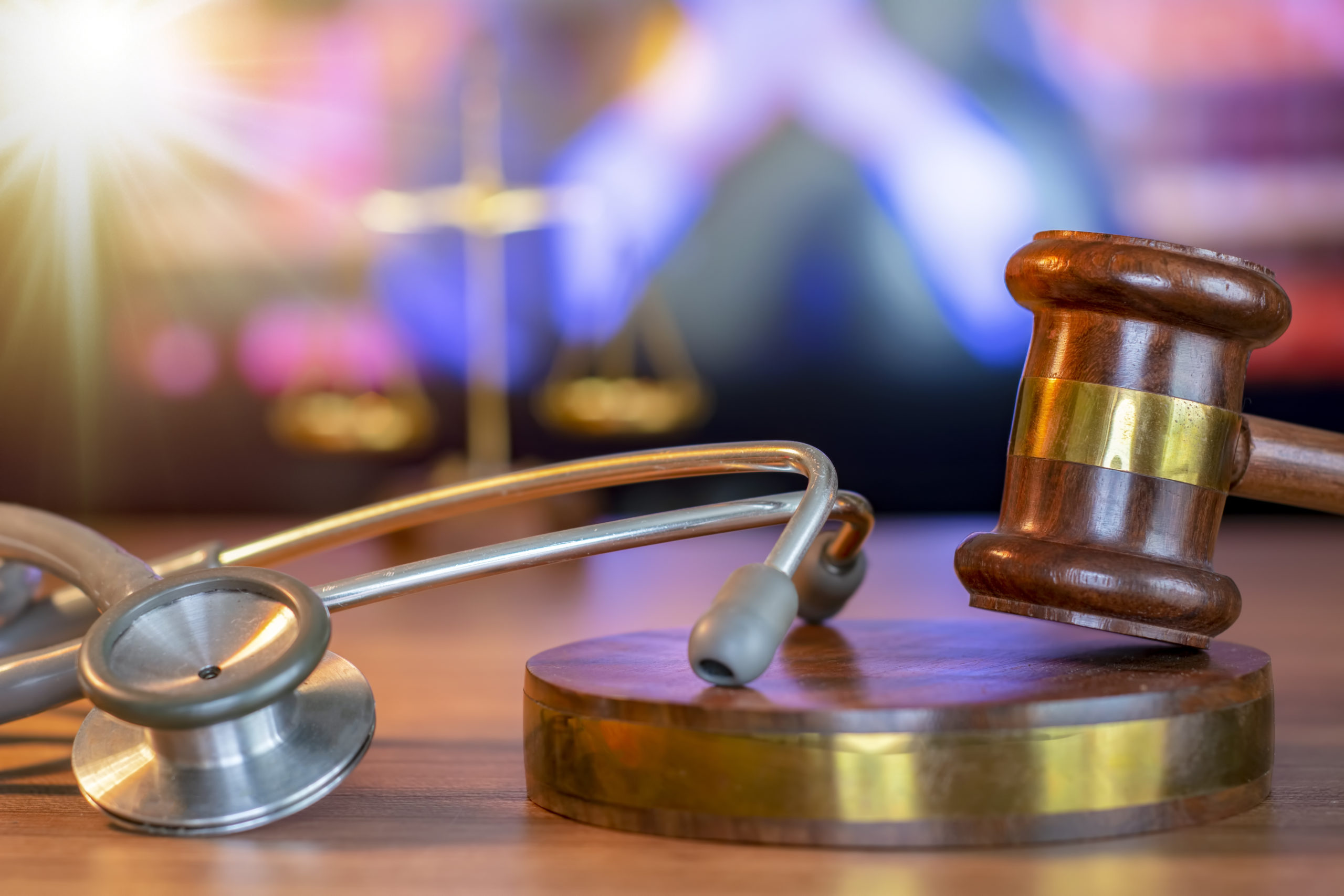 Justice Gavel and stethoscope with red heart on background.law concept Judge law medical Pharmacy compliance Health care business rules.